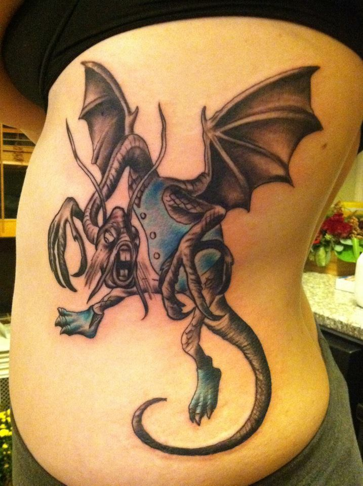15 tattoos inspired by alice 39 s adventures in wonderland for Looking glass tattoos