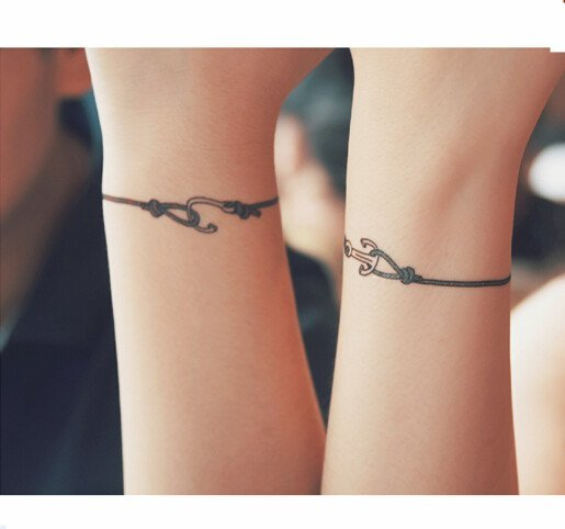 Wrist Tattoos That Are Better Than Bracelets You Are Here Guff Simple looking charm bracelet tattoo. wrist tattoos that are better than