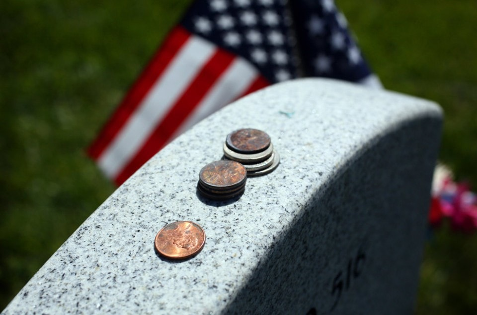 meaning of coins on a headstone